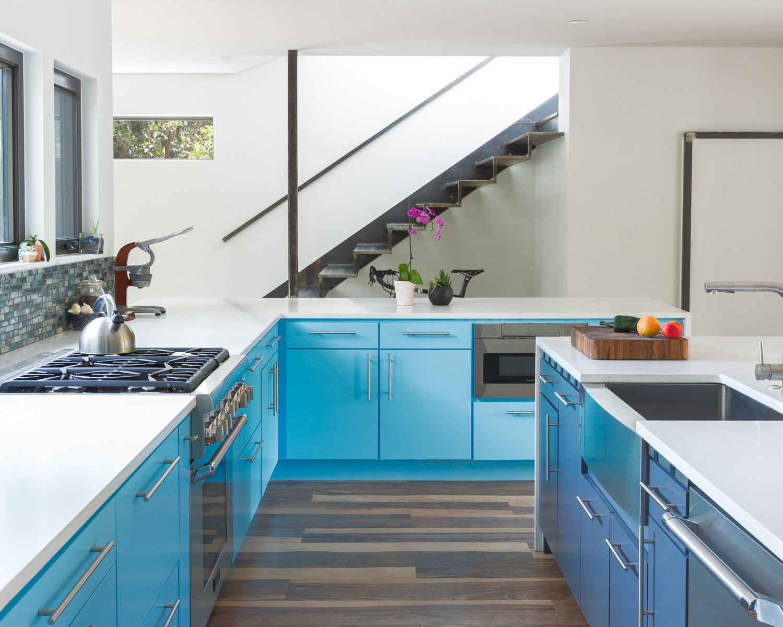 Kitchen, Engineered Quartz Counter, Ceiling Lighting, Medium Hardwood Floor, Colorful Cabinet, Range, Glass Tile Backsplashe, and Undermount Sink Kitchen - Open Floor Plan  Best Photos from Norris House