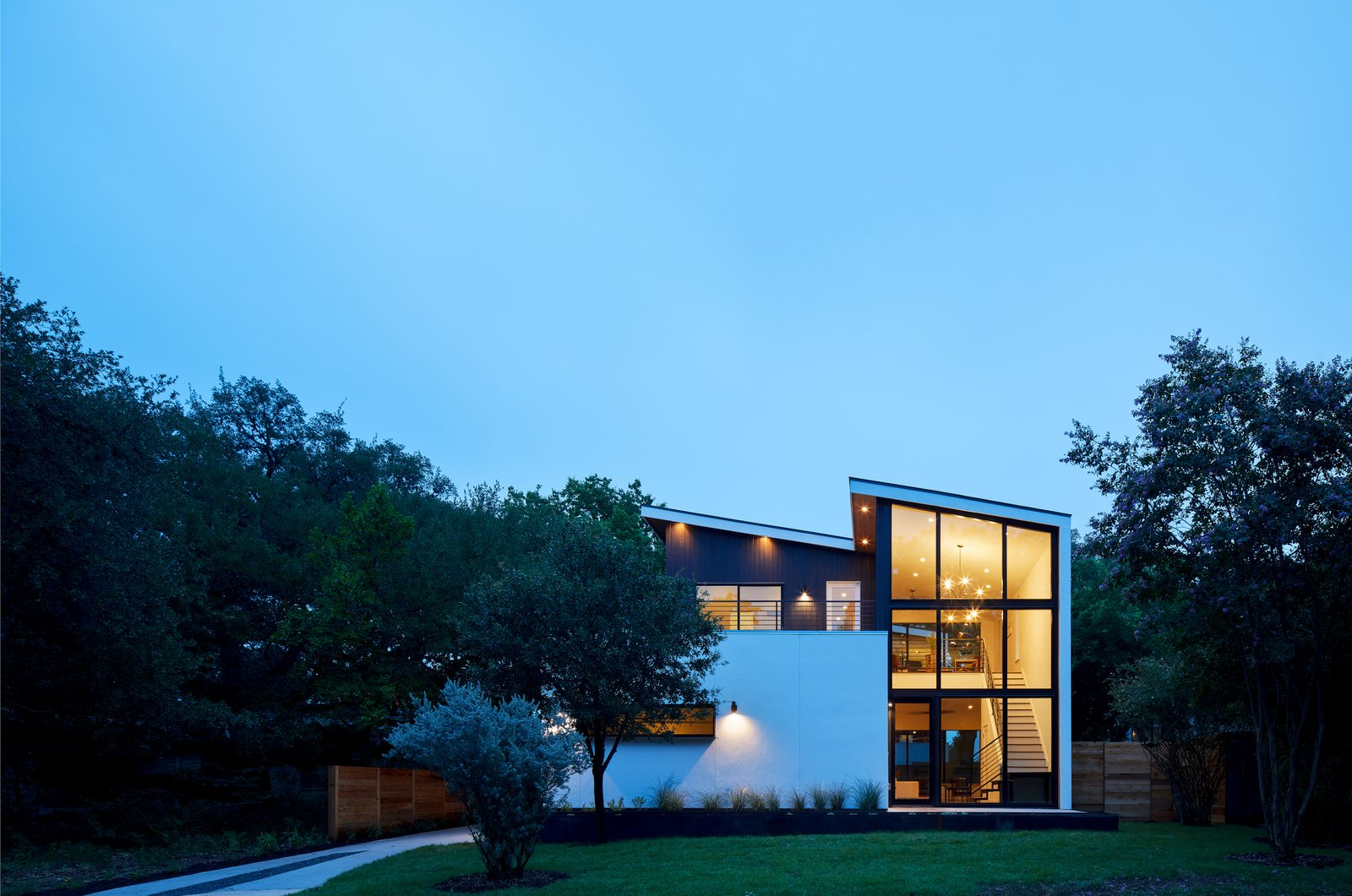 Exterior, Shed RoofLine, Metal Roof Material, Wood Siding Material, Stucco Siding Material, and House Building Type Exterior Dusk Shot  Chelsea House by Davey McEathron Architecture