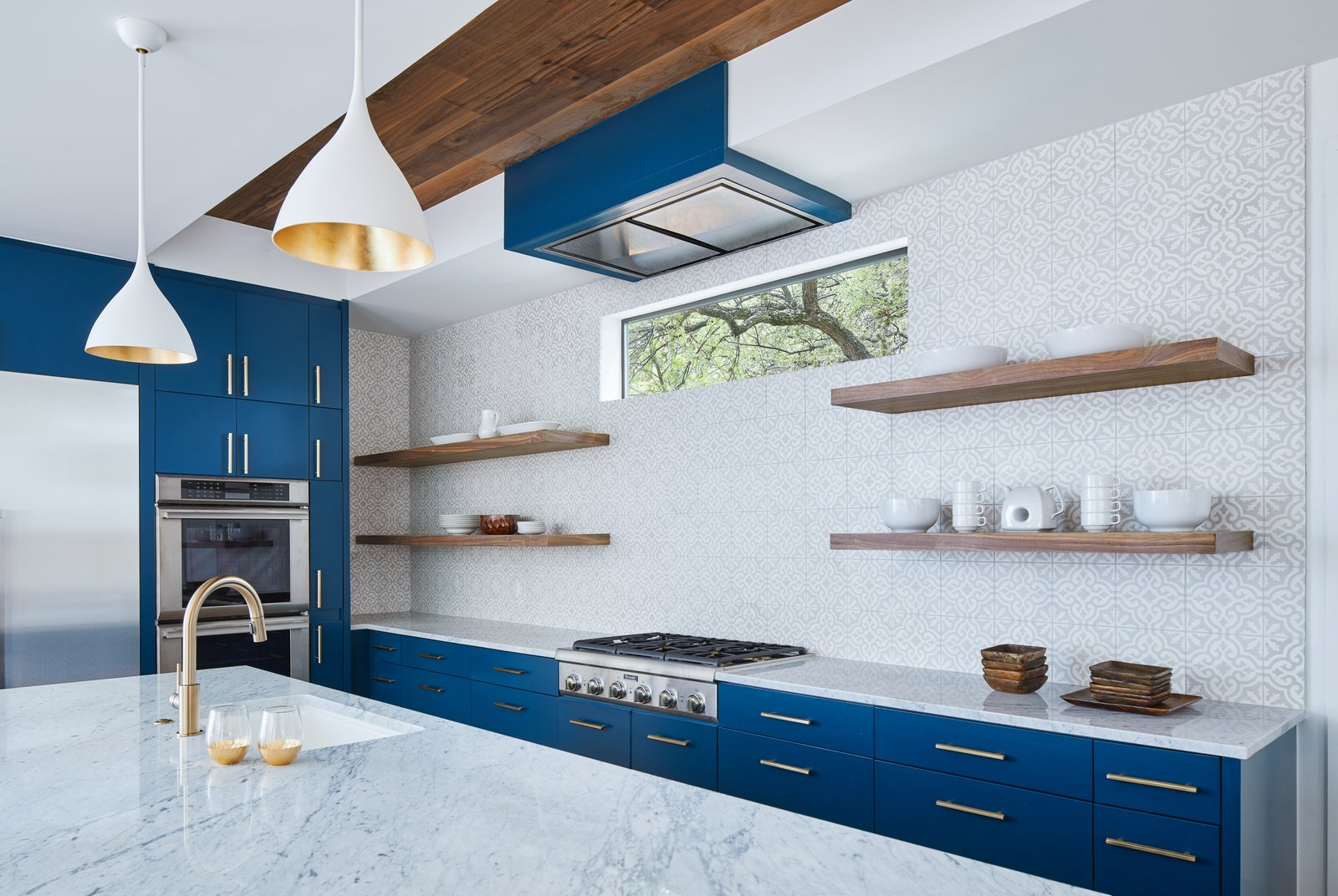 Kitchen, Refrigerator, Wine Cooler, Marble, Range Hood, Wall Oven, Colorful, Concrete, Dark Hardwood, Stone Tile, Cooktops, Pendant, Ceramic Tile, Ceiling, and Undermount Kitchen  Best Kitchen Cooktops Undermount Concrete Wall Oven Stone Tile Photos from Chelsea House