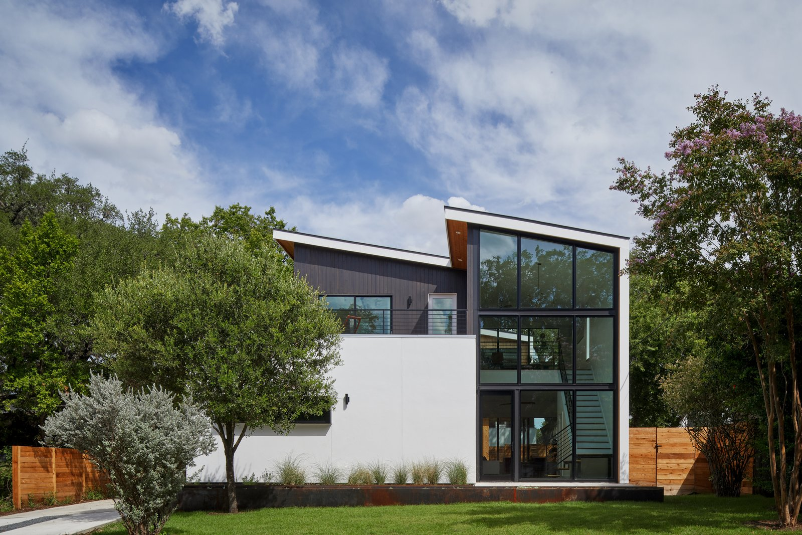Exterior, House Building Type, Flat RoofLine, Shed RoofLine, Wood Siding Material, Metal Roof Material, and Stucco Siding Material Exterior - Front  Chelsea House by Davey McEathron Architecture