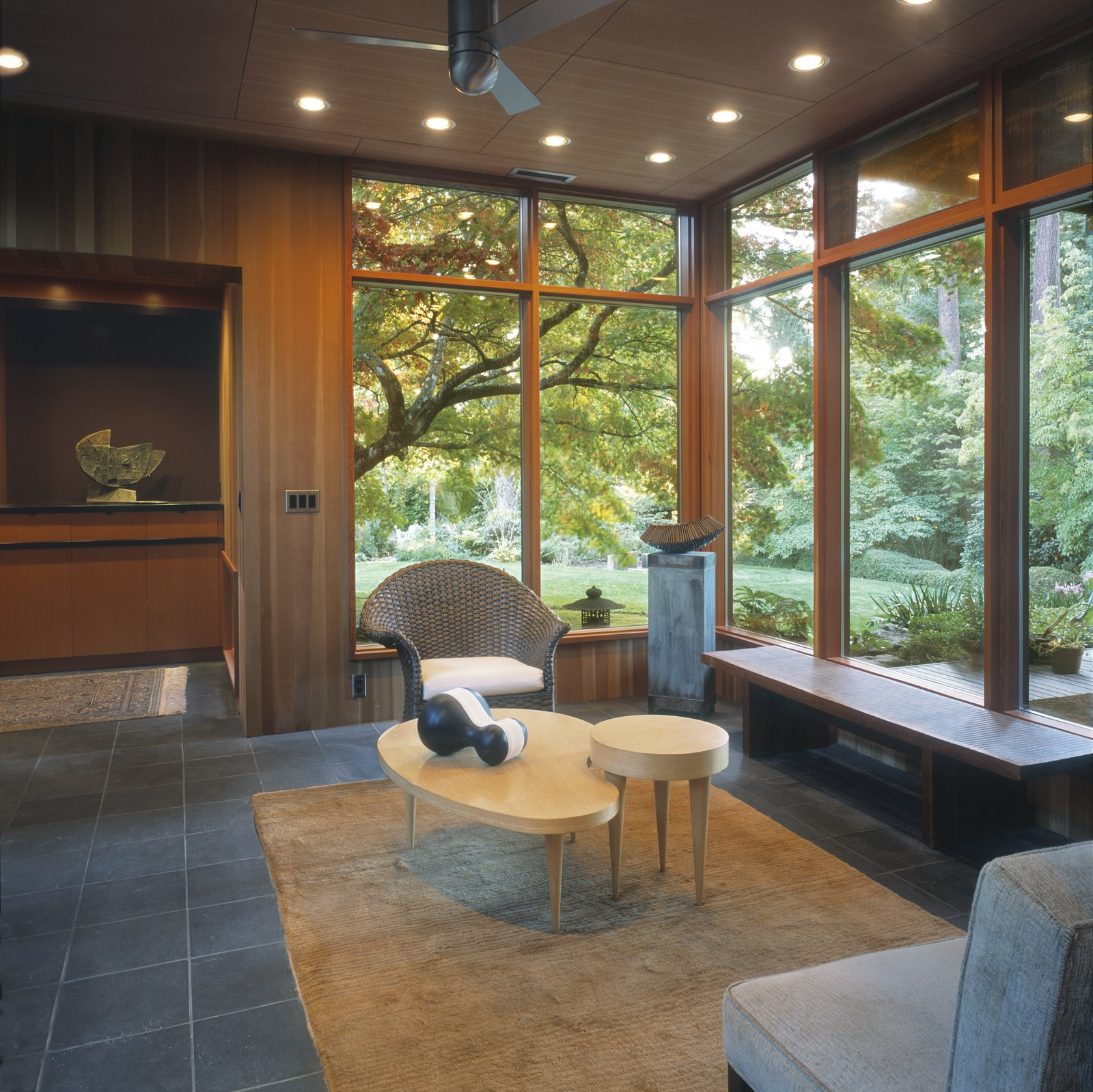 The sitting room enjoys views towards the lush garden beyond.    Belluschi Addition by Richard Brown Architect