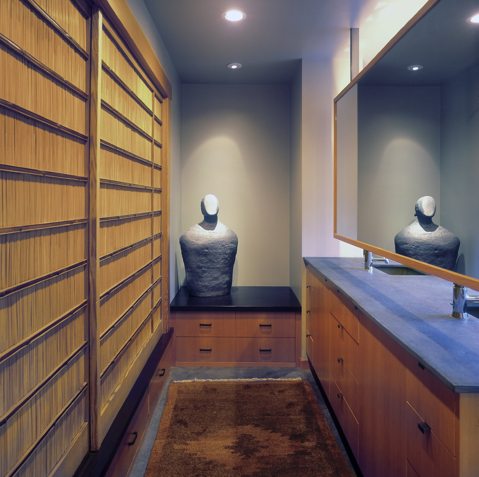 The Master Bath incorporates a changing area with ample storage and a series of antique Japanese sliding screens.  Belluschi Addition by Richard Brown Architect