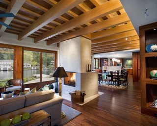 The Great Room sits below a lattice of Douglas Fir beams.  Mahogany floors and casework evoke the traditional materials of Pacific Rim architecture.