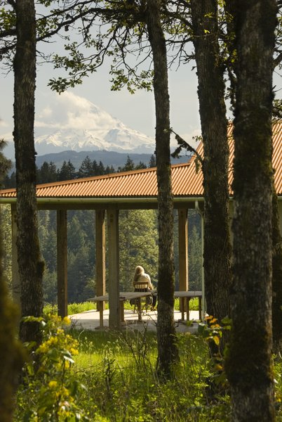 A generous porch offers views over the Columbia Gorge towards the mountain range beyond.