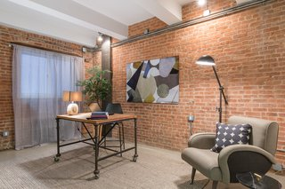 Private study with brick walls and industrial accents