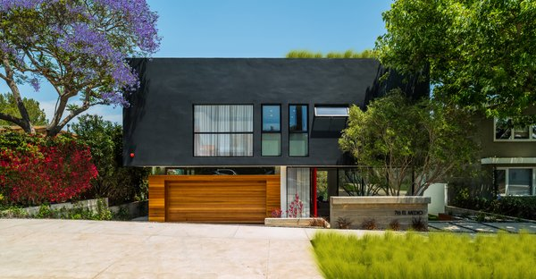 The design of this Pacific Palisades home was driven by the neighborhood's hillside ordinance. After studying various versions of the property, the architects decided that by dropping the street facade by four feet, they would be able to achieve a more linear design. A rooftop deck allows the homeowners to enjoy panoramic views of the Pacific Ocean.  The Middle House by bryan winters, aia, ncarb