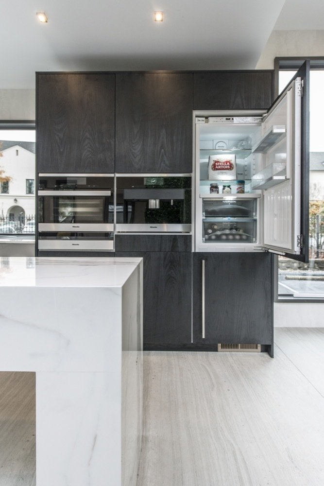 Kitchen Wall Oven Wood Cabinet Marble Counter Light Hardwood Floor Refrigerator