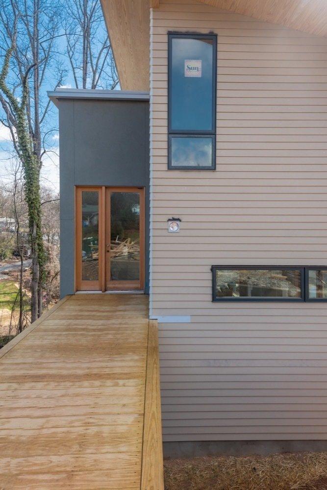 Asheville Design Economy Credits  Architecture: Rusafova Markulis Architects, Mountain Sun Builders General Contractor: Mountain Sun Builders  Shelburne Woods