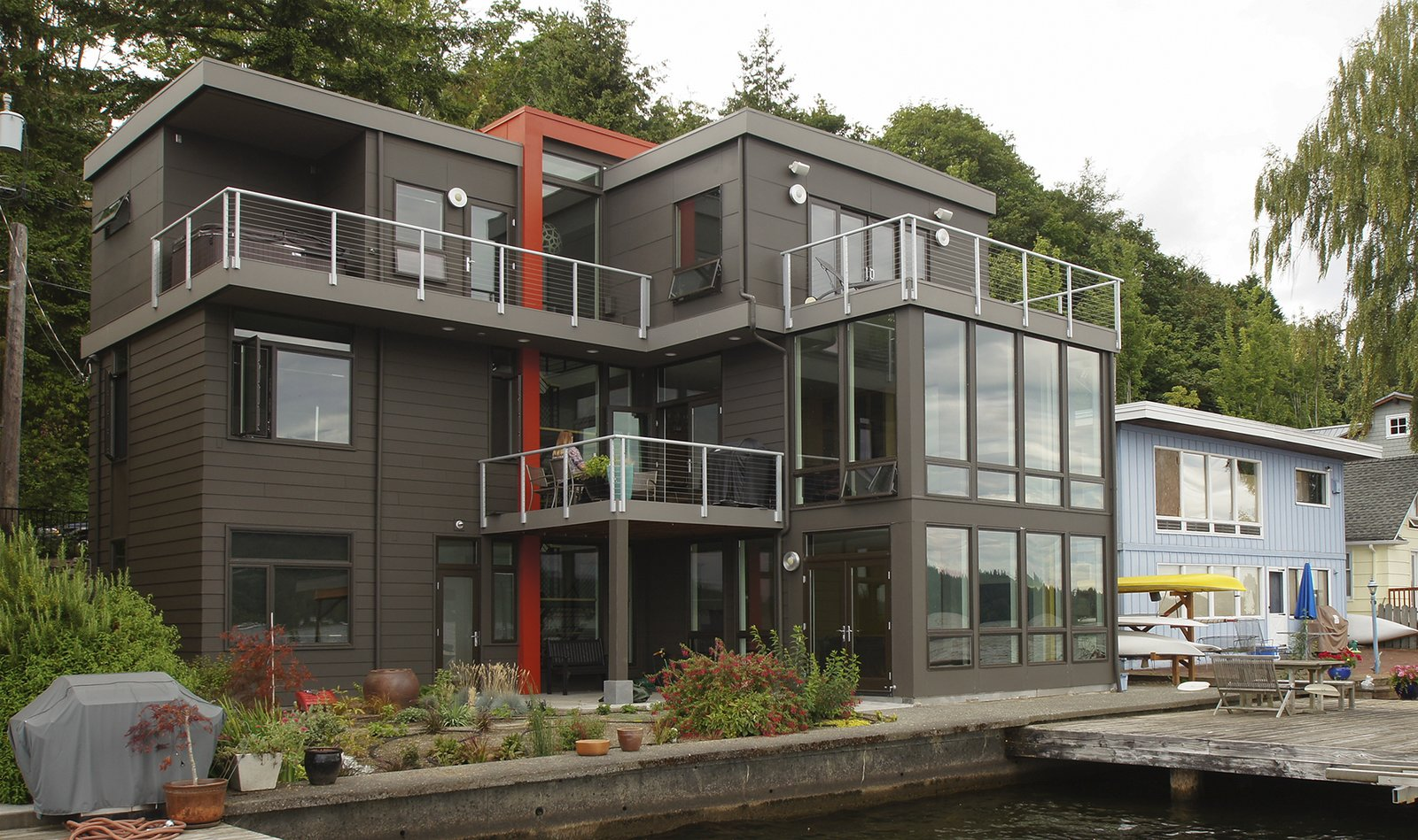 This modern home uses color and siding patterns to help distinguish the house. The large amounts of glazing provide views of the lake from all rooms.  Lake Washington Home by Atelier Drome
