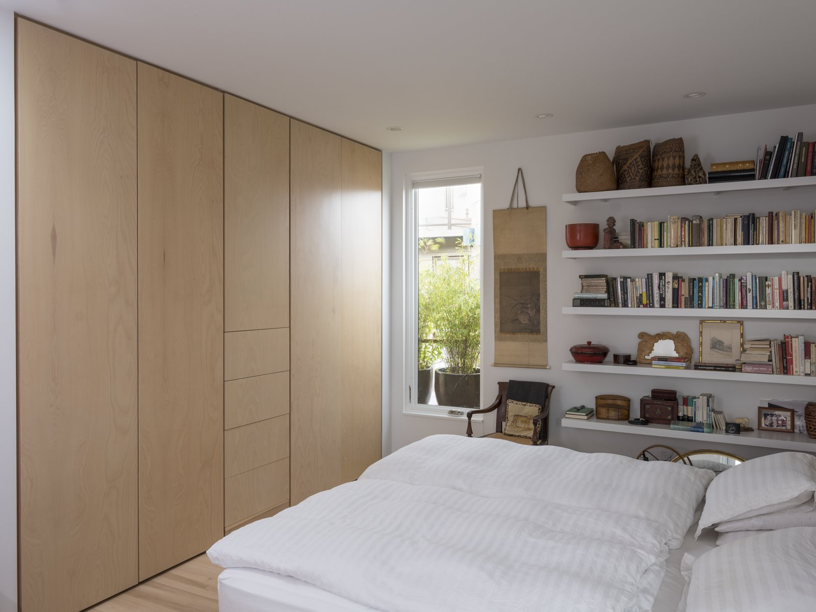 Bedroom, Light Hardwood, Bed, Bookcase, Wardrobe, Storage, Recessed, and Chair Master Bedroom  Best Bedroom Wardrobe Bookcase Photos from Lake Union Floating Home