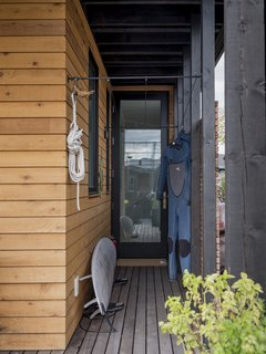 Wrap around ipe deck with doors to every room and storage