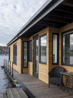 Cedar siding and wrap around ipe deck with sitting areas
