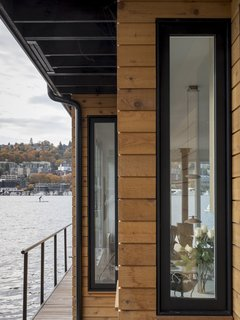 Exterior with cedar siding and large windows