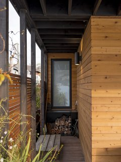 Exterior with cedar slat screen wall and additional storage