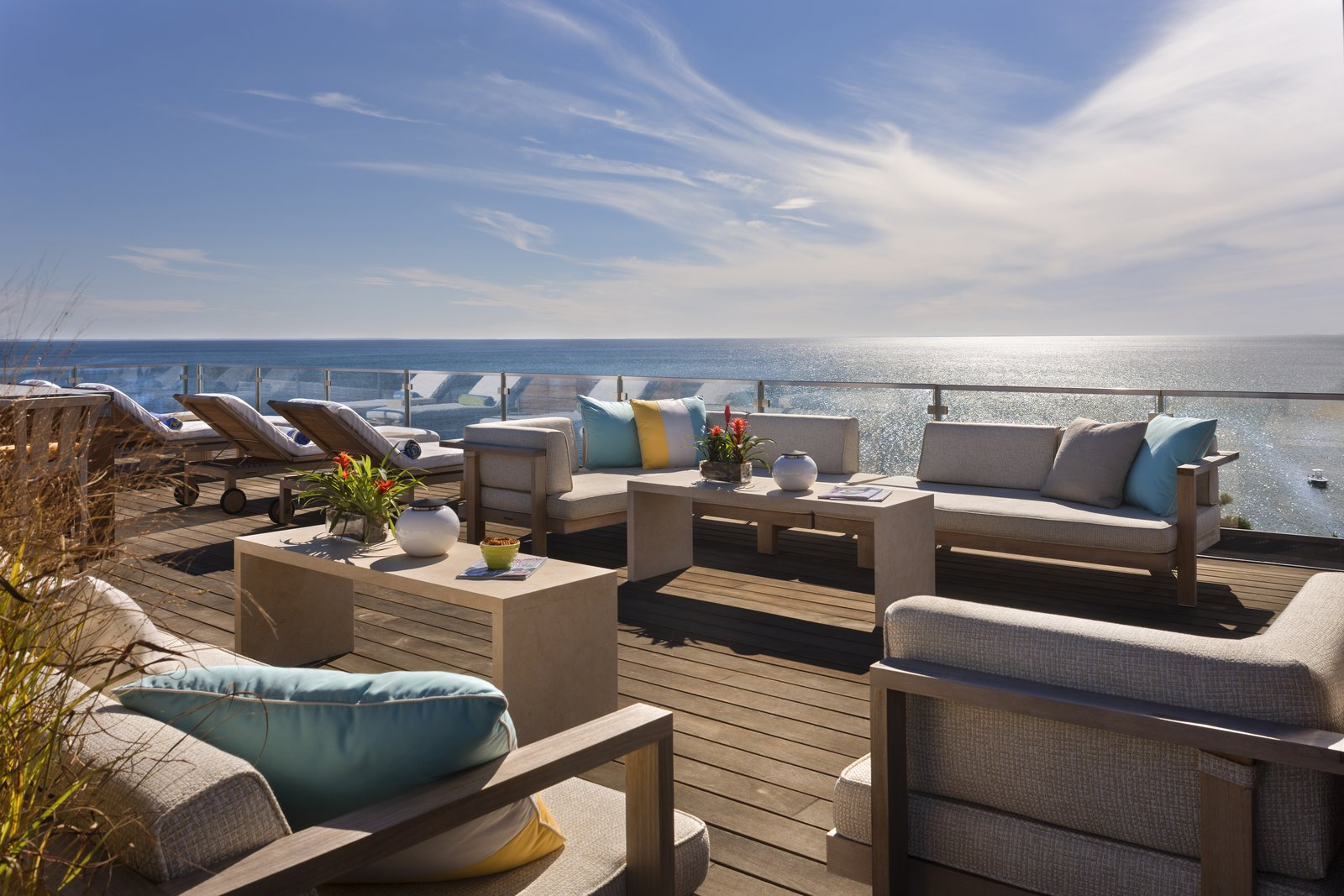 Sweeping views on the spacious roof deck create the perfect place to relax or entertain.  The Cape