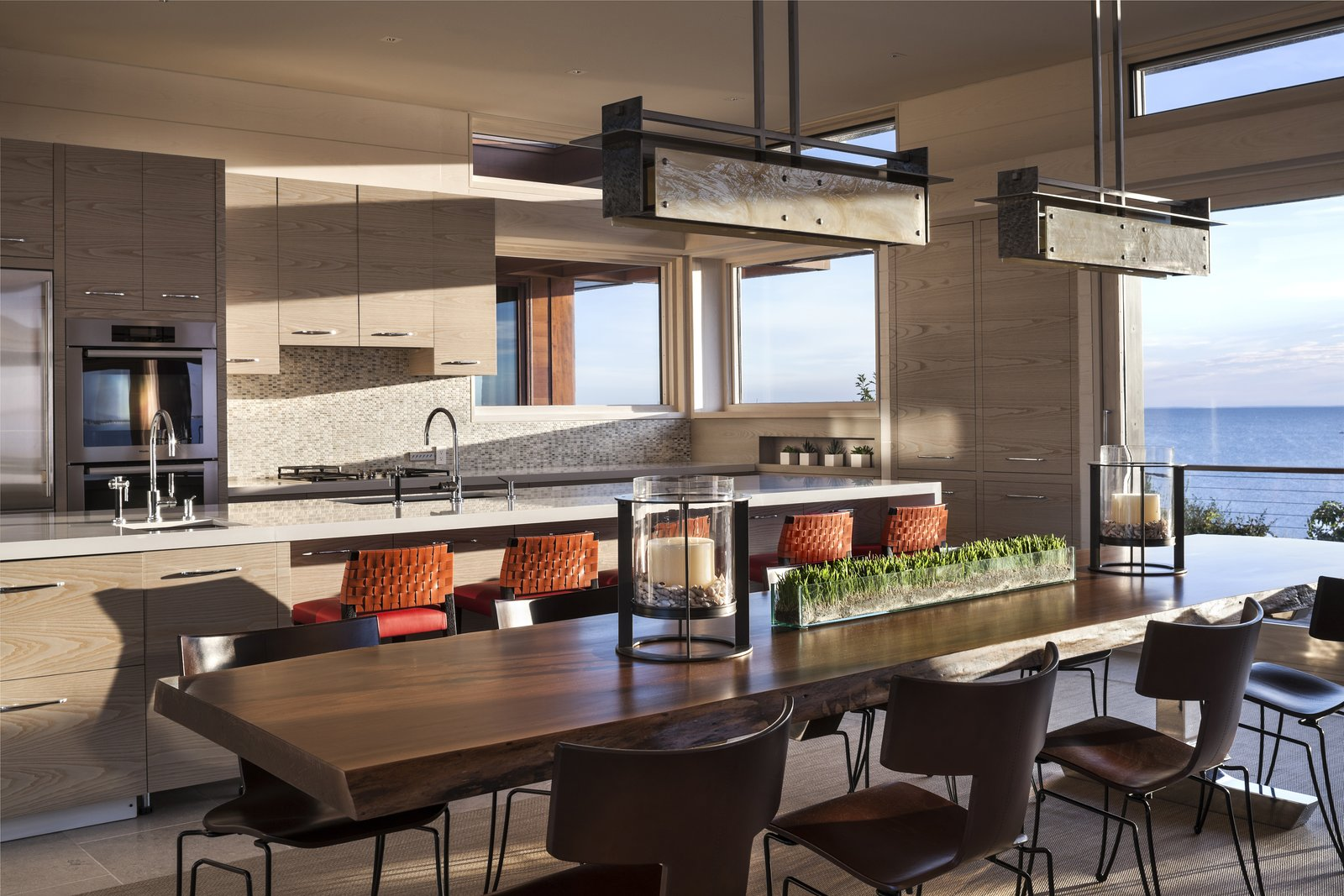 The open layout seamlessly connects kitchen, dining, and living spaces.  The Cape