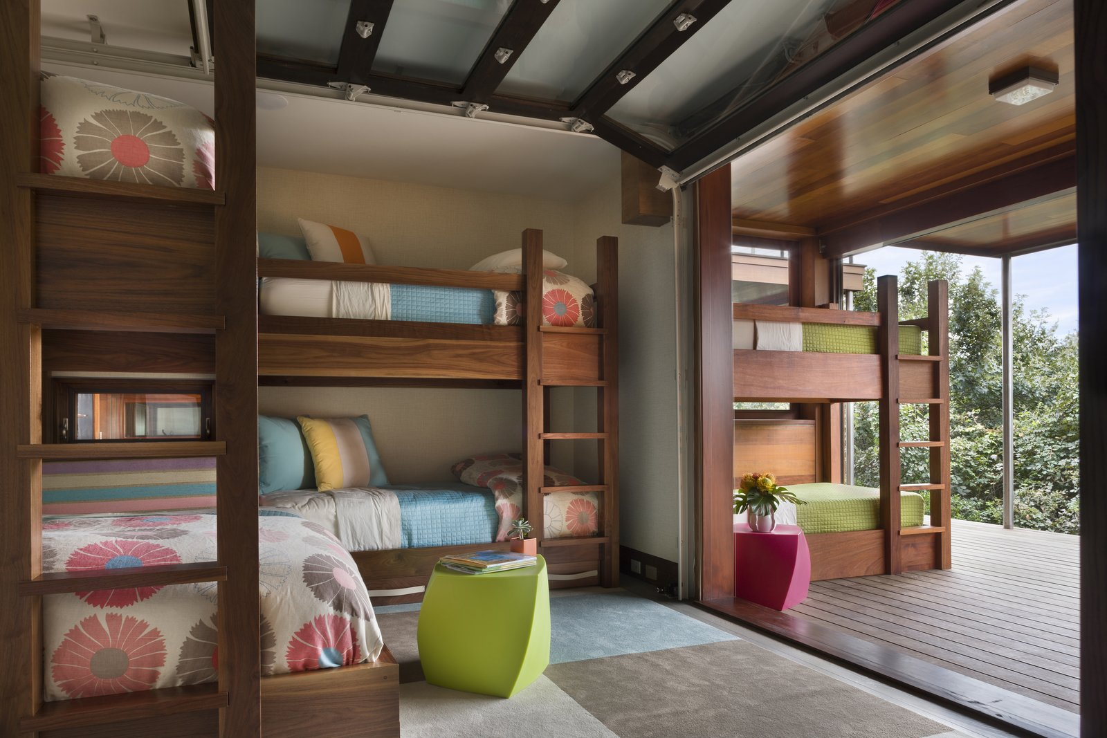 Garage-style doors open and connect the children's rooms to the outdoors.  The Cape