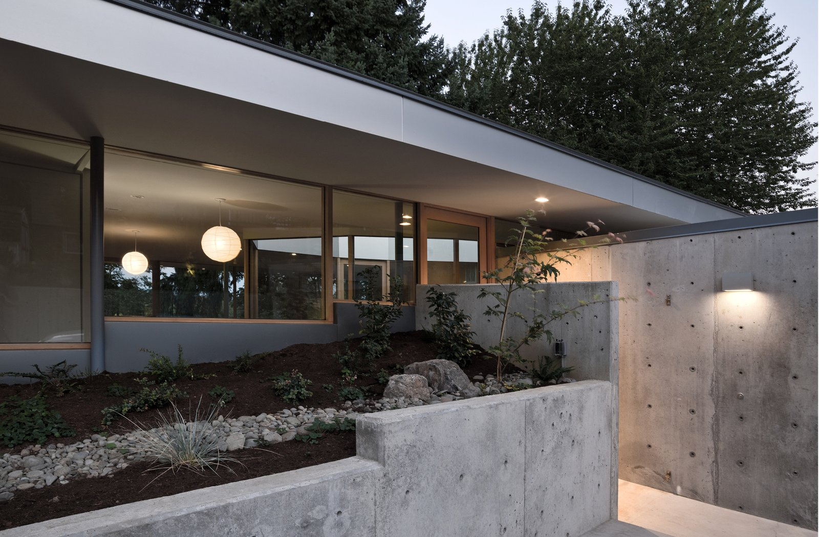Entered through a sunken patio, the house flows in a continuous loop around two L-shaped storage cores.  The Courtyard House