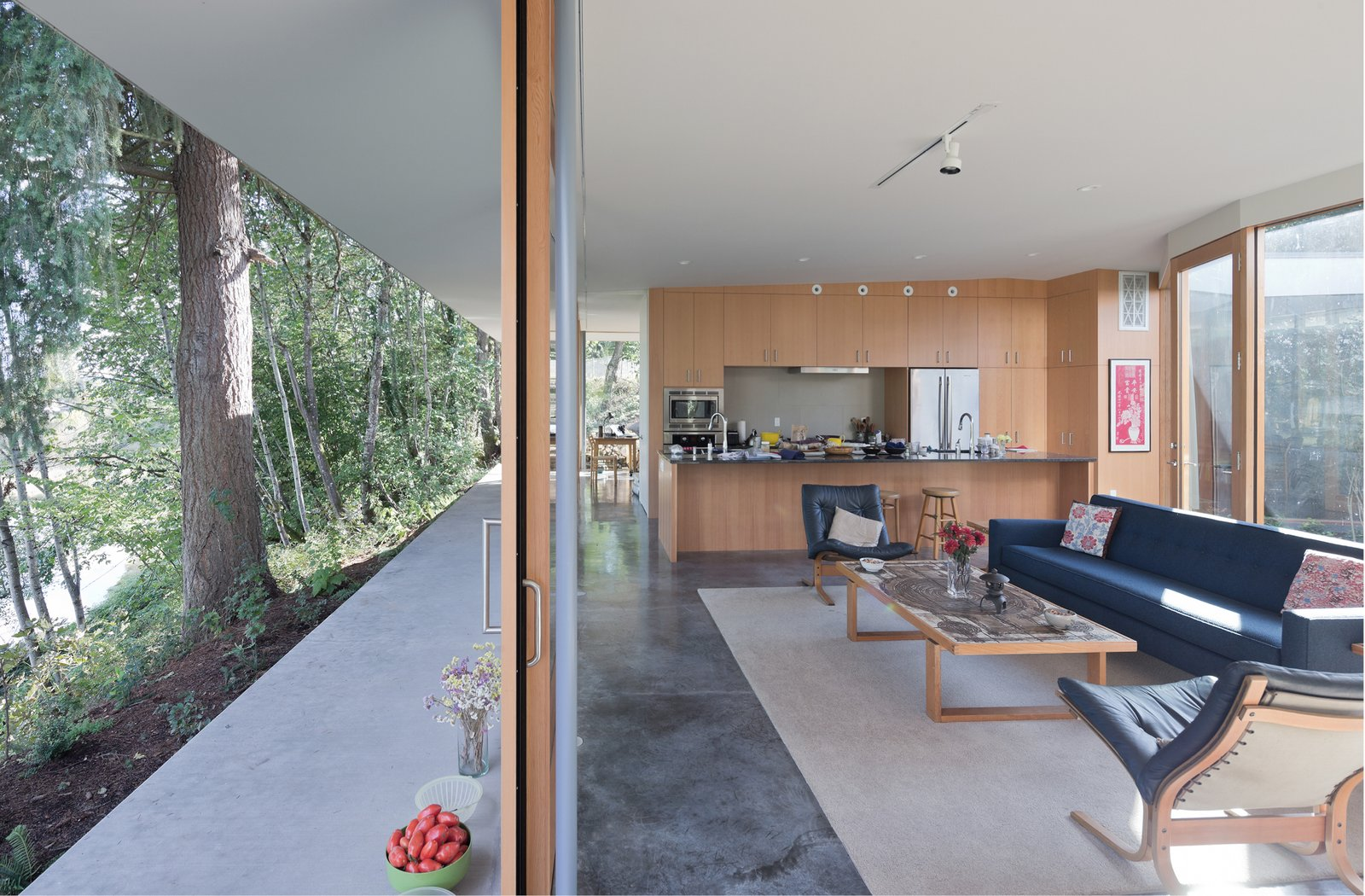 A matrix of rooms separate and connect around the L-shaped bathroom and storage cores made flexible by concealed doors at their ends.   The Courtyard House