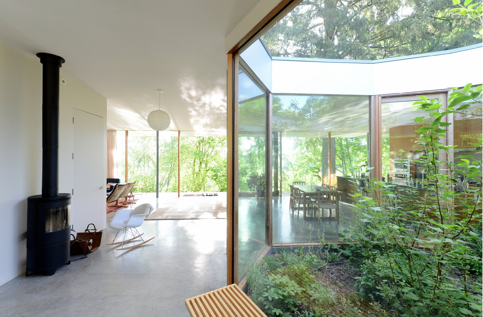 In the wintertime, the courtyard's position increases the passive heating of the sun, while in the summertime, shaded by native deciduous trees, the courtyard stimulates natural ventilation and passive cooling.  The Courtyard House