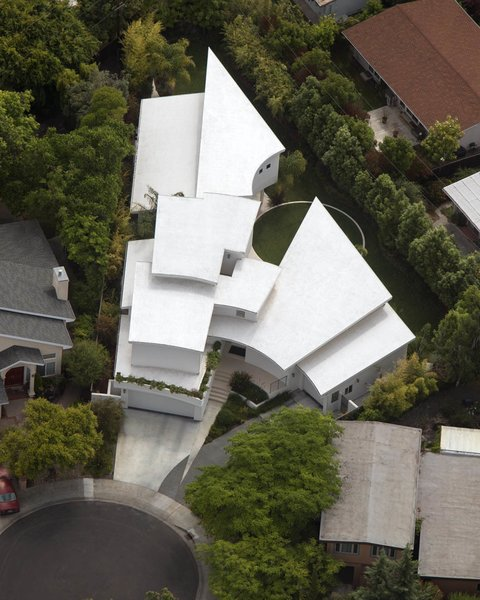Outdoor and Rooftop Aerial image reveals attachment of building lines to  property lines and the large yard generated as a result.  Contemporary Eichler Offspring by Agnieszka Jakubowicz