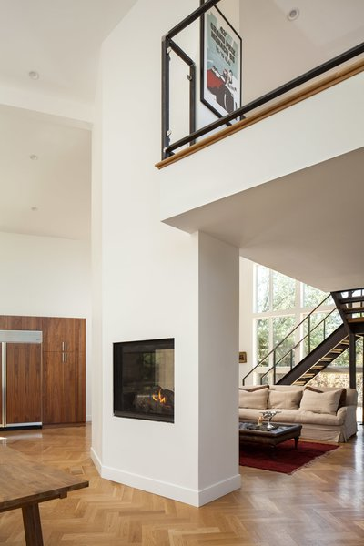 Two-sided fireplace reaches mezzanine.