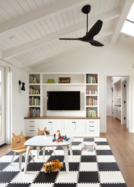 Custom-designed storage and entertainment fixtures create family gathering spaces in the Wooodside Residence.