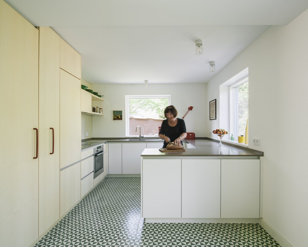 Kitchen, Engineered Quartz Counter, Cement Tile Floor, White Cabinet, Wood Cabinet, Wood Backsplashe, Drop In Sink, and Ceiling Lighting kitchen  Haus Mai by Project Architecture Company