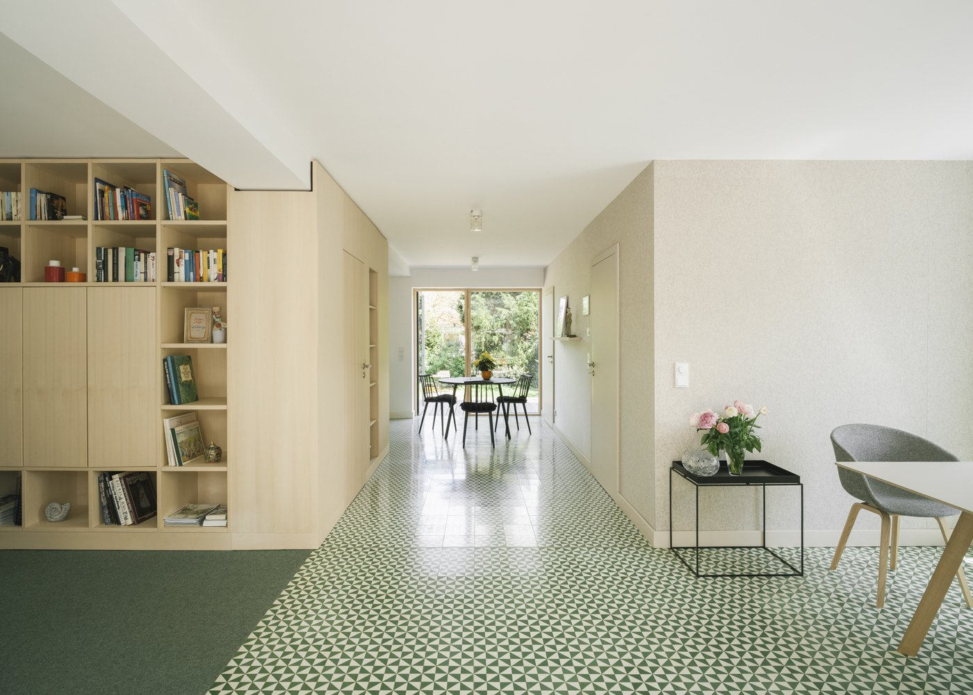 Cement Tile Floor, Carpet Floor, Shelves, Storage, Chair, and Dining Room open plan living room  Haus Mai by Project Architecture Company