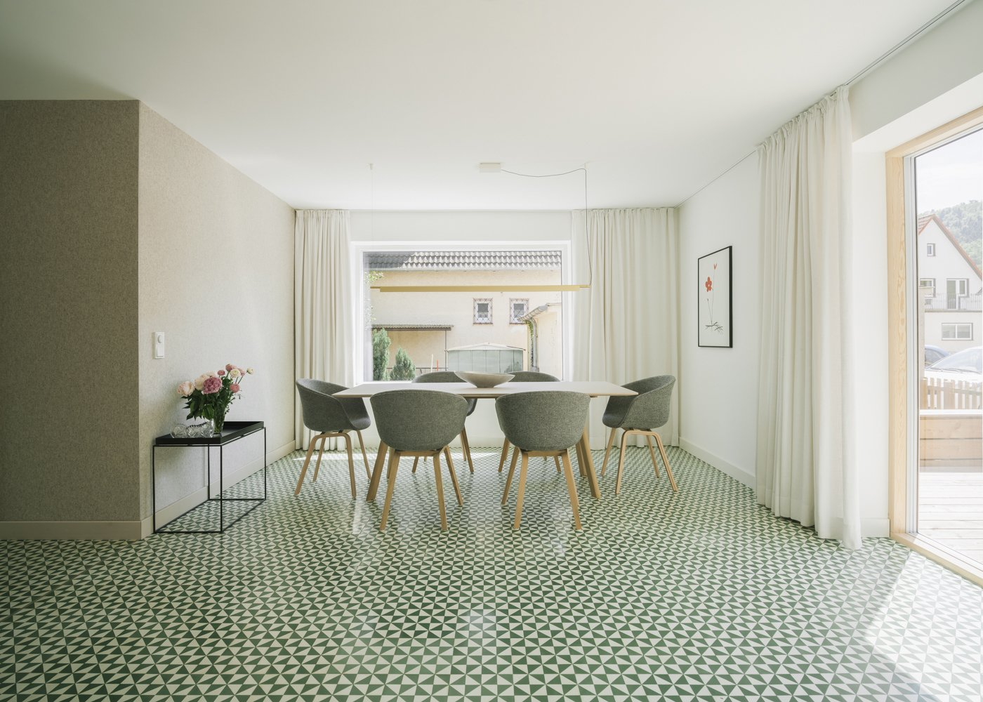 Dining Room, Chair, Table, Lamps, Pendant Lighting, and Cement Tile Floor dining table  Haus Mai by Project Architecture Company