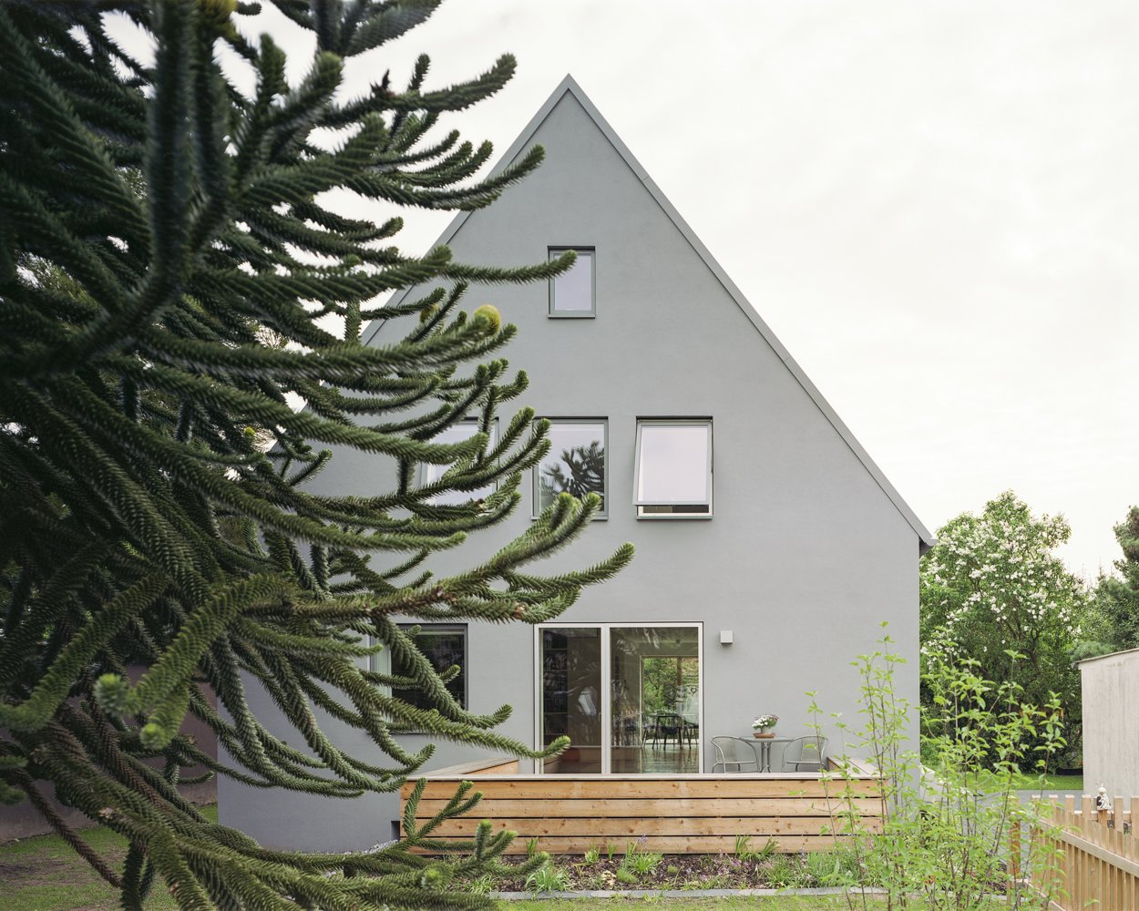 Outdoor, Front Yard, Wood Patio, Porch, Deck, Trees, Decking Patio, Porch, Deck, and Garden new street facade  Haus Mai by Project Architecture Company