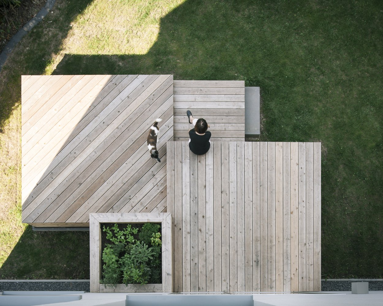 Outdoor, Decking, Wood, and Planters the owners enjoying the new garden terrace  Dwell's Favorite Outdoor Planters Photos from Haus Mai
