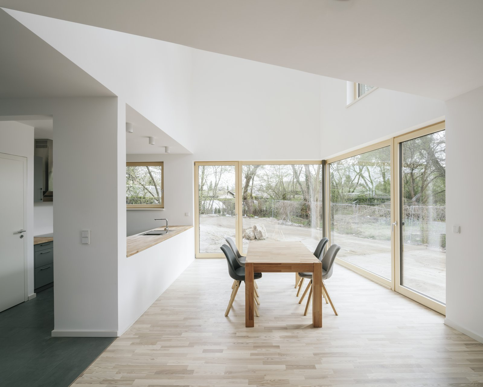 Dining Room, Table, Chair, and Medium Hardwood Floor dining area  Haus P by Project Architecture Company
