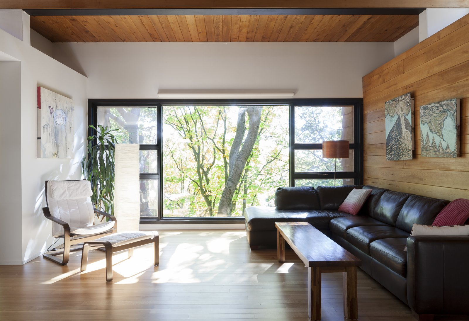Living Room, Sofa, Chair, Sectional, Lamps, Coffee Tables, Floor Lighting, Medium Hardwood Floor, and Light Hardwood Floor Living room - Rue de l'Espéranto residence  - Guillaume Sasseville & PARKA - Architecture & Design  Photos from Rue de l'Espéranto residence