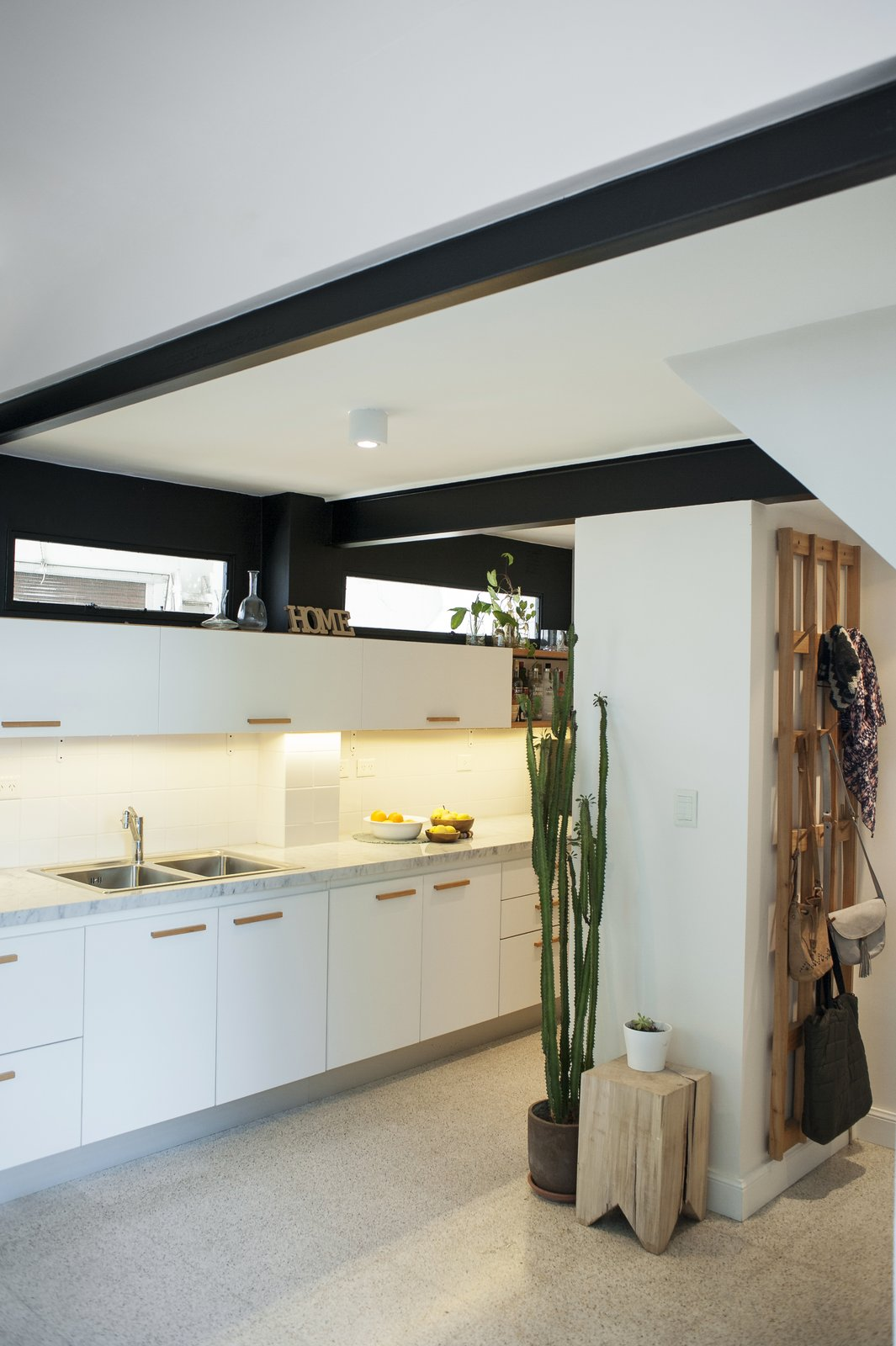 The original beams and the wall above the cupboard have been painted in black  Artigas