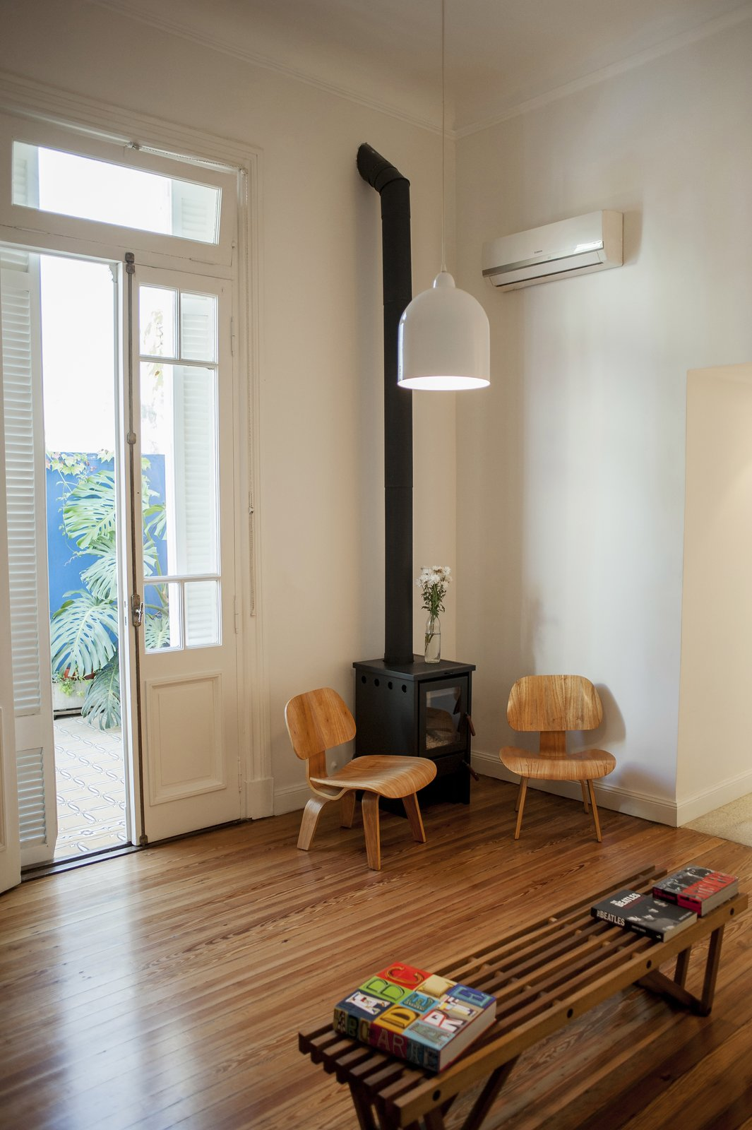 The living room preserves the original wooden floors and entrances  Artigas