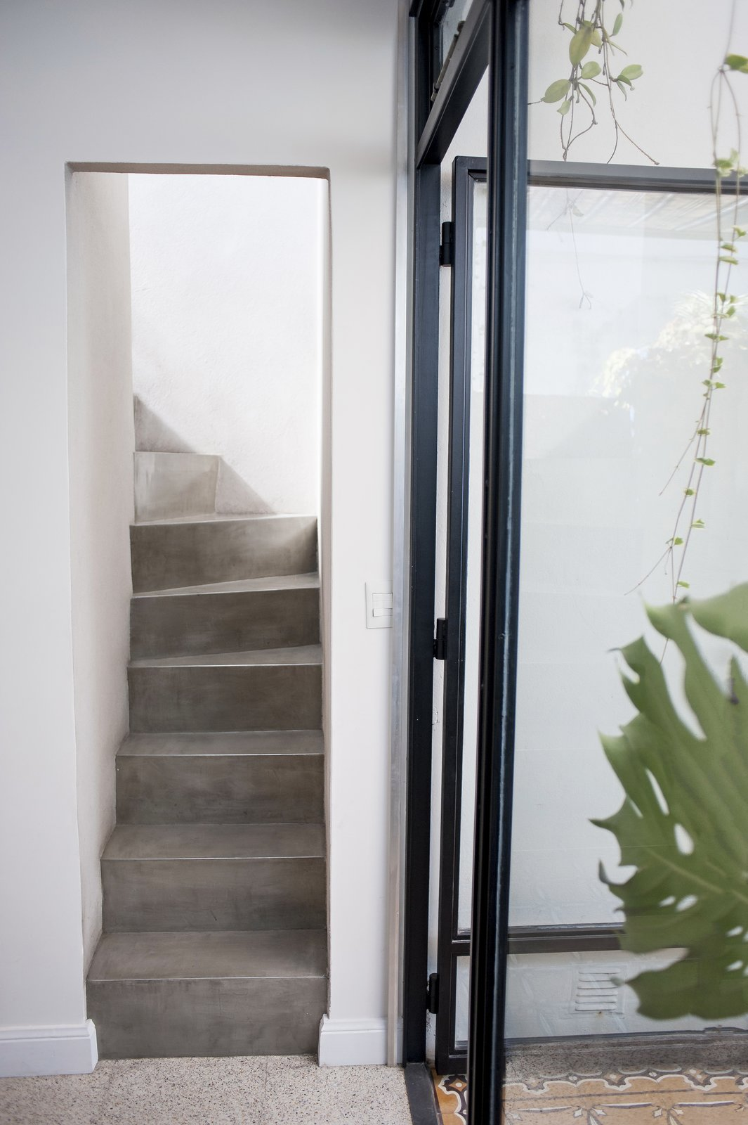 The stairs that used to be out in the patio are now inside thanks to the window and cealing that has been built after them.  Artigas