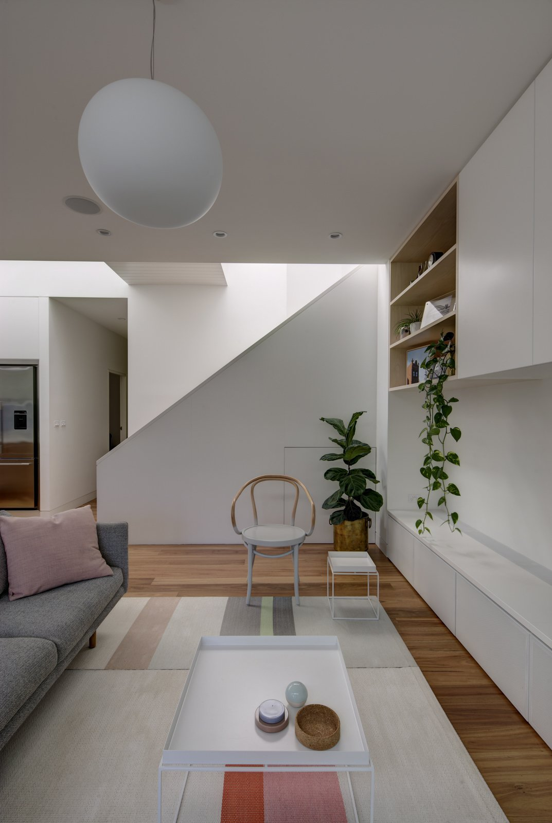 Living Room, Sofa, Chair, Coffee Tables, Bookcase, Ceiling Lighting, and Medium Hardwood Floor Colourful furnishings animate the space. Thonet armchair, Jardan Nook lounge and Hay side tables provide a comfortable, deliberately low key setting.  Best Photos from Inner West House