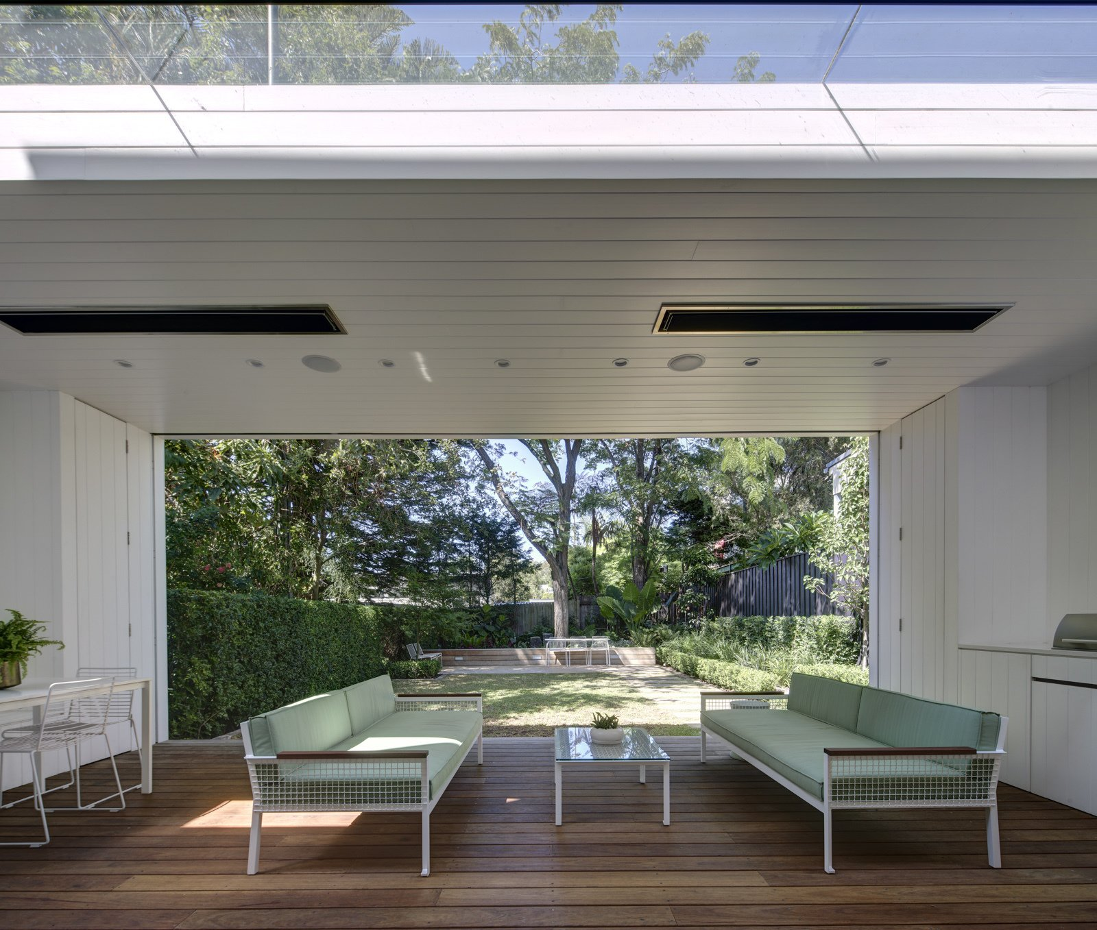 The garden room frames the landscape and becomes an extension of the interior spaces. White painted lining boards wrap the space and echo the traditional palette of the cottage.  Photo 3 of 6 in Top 5 Homes of the Week With Amazing Outdoor Spaces from Inner West House