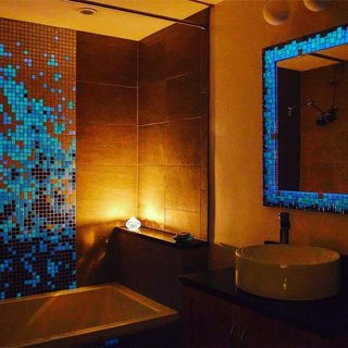 The design possibilities are endless with Susan Jablon's Glow in the Dark Glass Tiles, but this bathroom remodel is magnificent! Shop these tiles here: https://www.susanjablon.com/catalogsearch/result/?q=glow+in+the+dark+glass+tiles