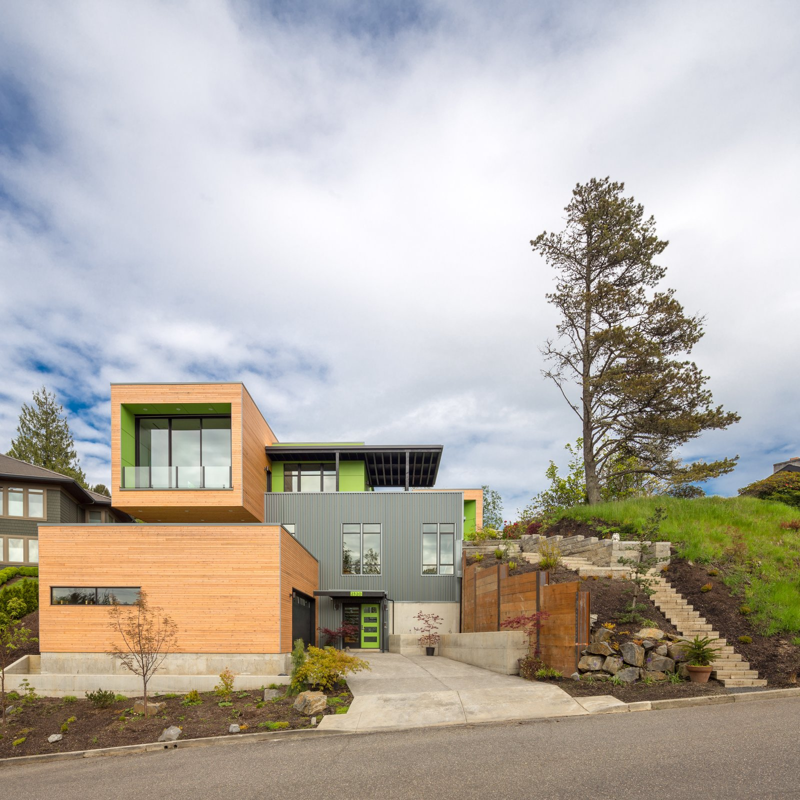 Exterior, House Building Type, Wood Siding Material, and Metal Siding Material Front street side elevation  Panavista Hill House by Steelhead Architecture