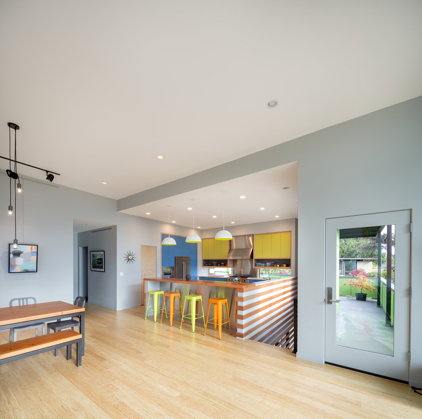 Kitchen, Quartzite Counter, Wood Counter, Colorful Cabinet, Medium Hardwood Floor, Pendant Lighting, and Recessed Lighting Living / dining / kitchen  Panavista Hill House by Steelhead Architecture