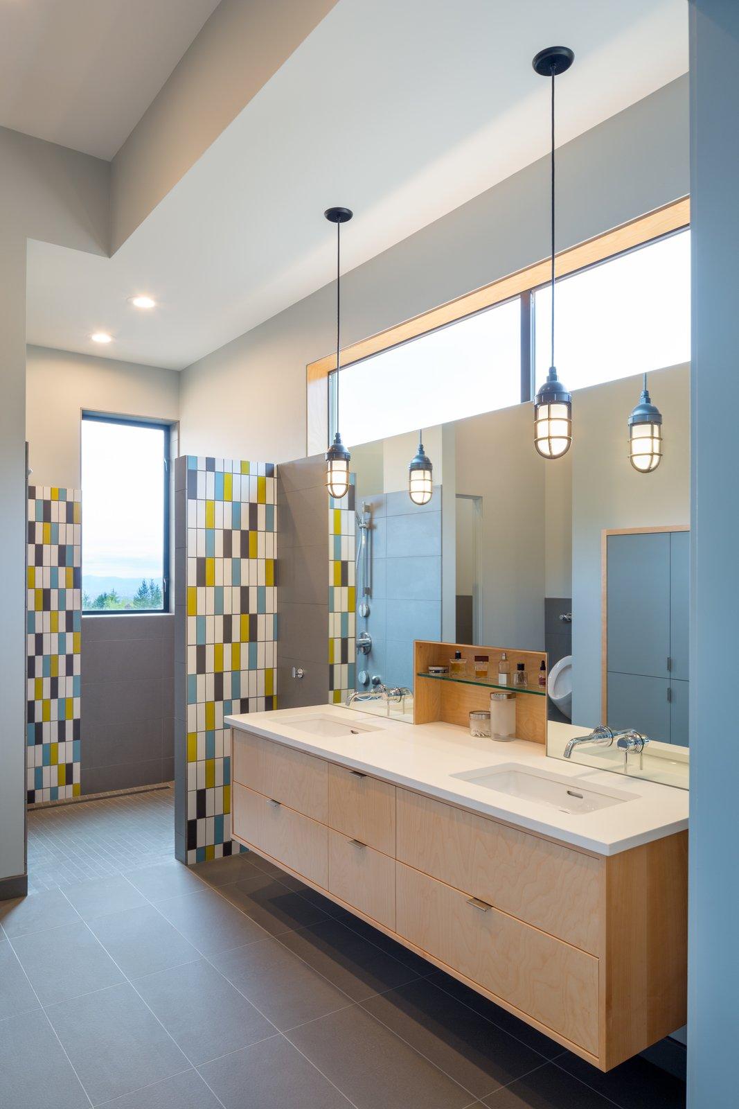 Bath Room, Quartzite Counter, Undermount Sink, Open Shower, Recessed Lighting, Porcelain Tile Wall, Porcelain Tile Floor, and Pendant Lighting Master bathroom  Panavista Hill House by Steelhead Architecture
