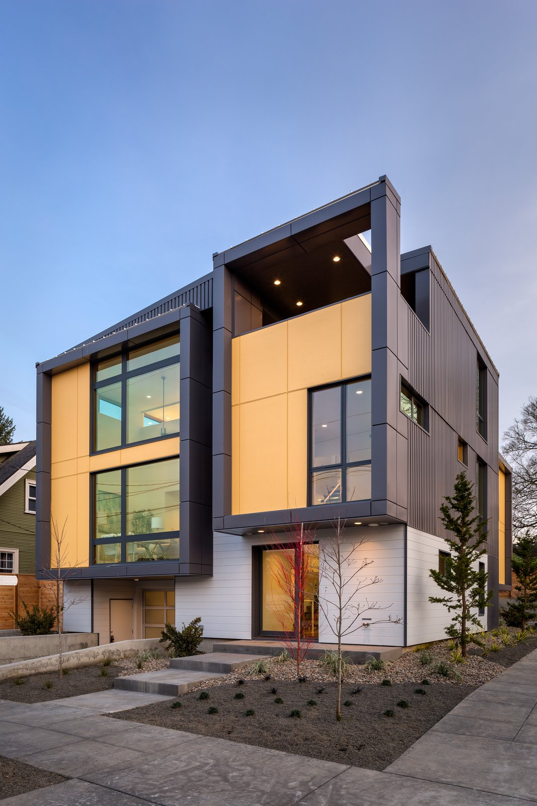 Exterior, Metal Roof Material, House Building Type, Flat RoofLine, Metal Siding Material, and Shed RoofLine Exterior front corner with stepping tubes  Lightbox 23 by Steelhead Architecture