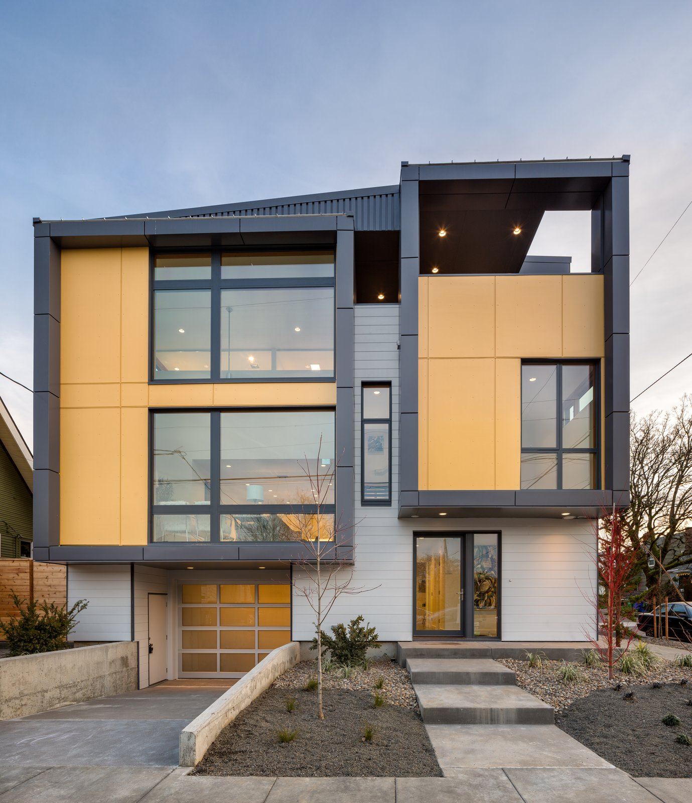 Exterior, Metal Roof Material, House Building Type, Flat RoofLine, Shed RoofLine, and Metal Siding Material Exterior elevation showing split levels  Lightbox 23 by Steelhead Architecture