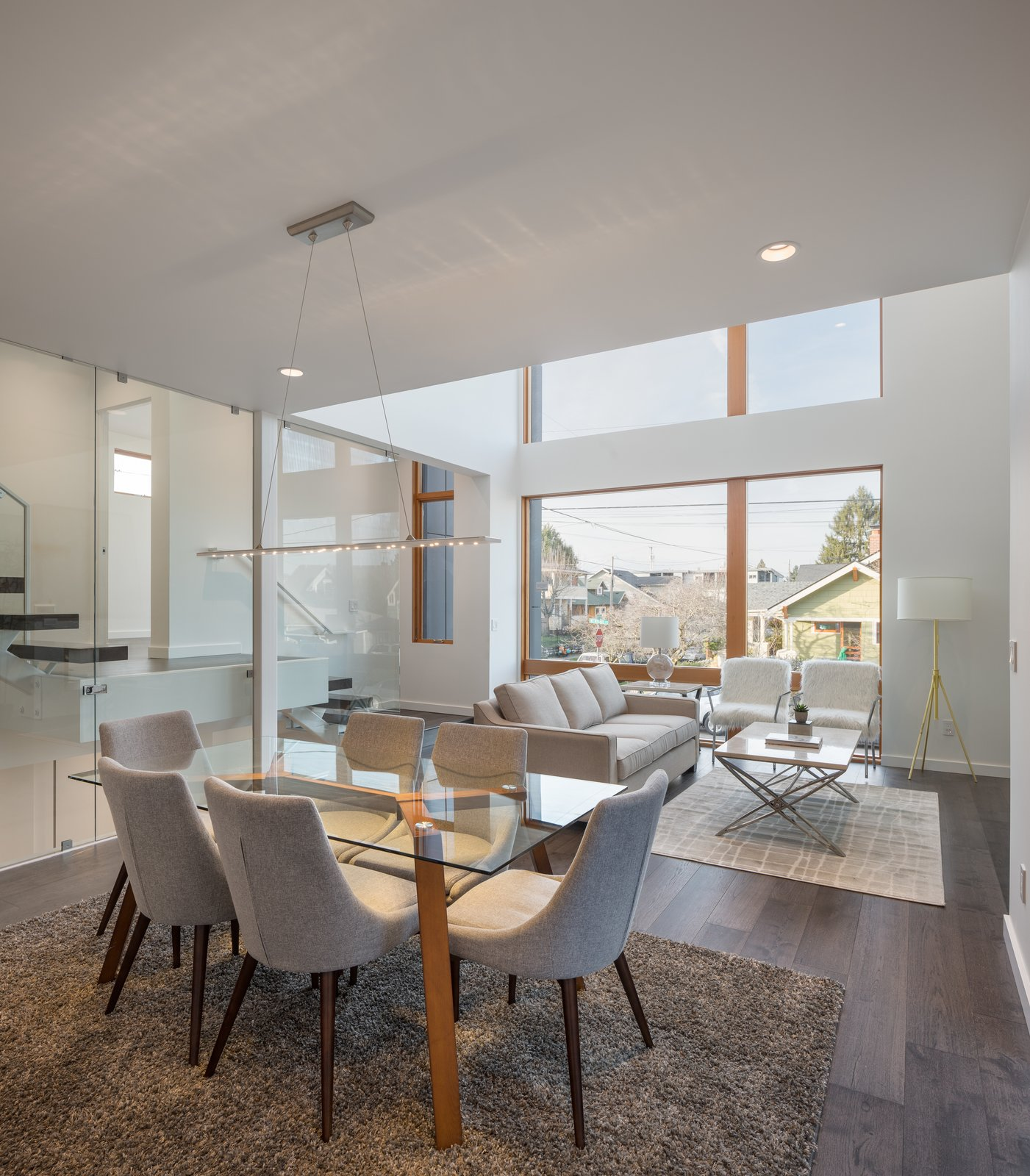 Dining Room, Chair, Pendant Lighting, Table, Recessed Lighting, and Medium Hardwood Floor Open living to the large expanses of glass.  Lightbox 23 by Steelhead Architecture