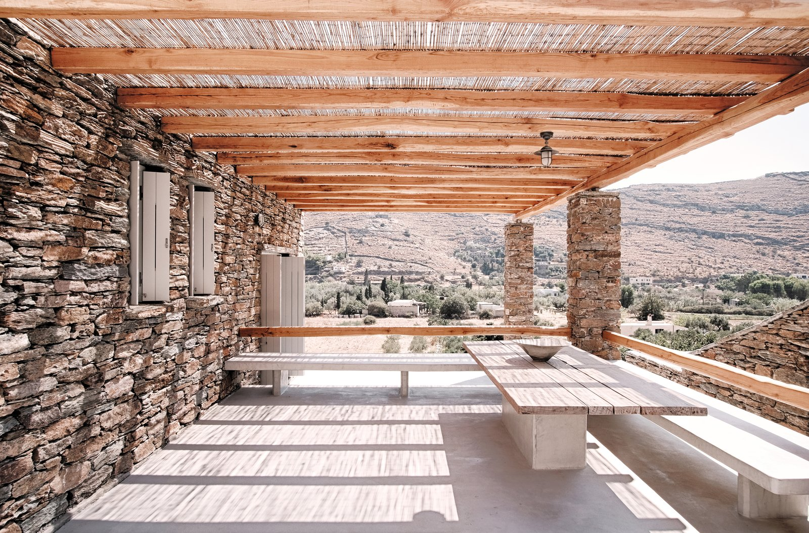 Outdoor, Back Yard, Desert, Small Patio, Porch, Deck, and Wood Patio, Porch, Deck Exterior eating area with views towards the valley  ROCKSPLIT house by COMETA ARCHITECTS