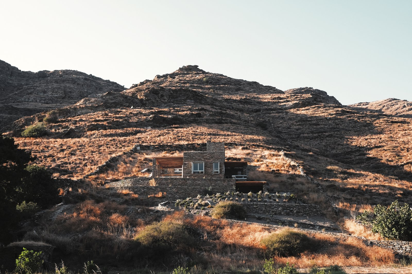 Outdoor, Desert, and Boulders Blended in the rock, south elevation  ROCKSPLIT house by COMETA ARCHITECTS