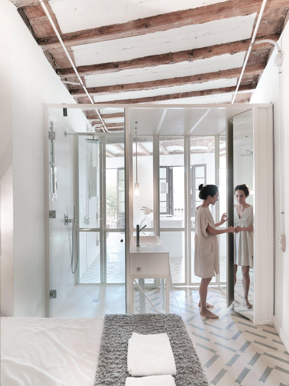 Strategically placed mirrors have placed  in order to stretch the space.  LIGHTSLICE apartment