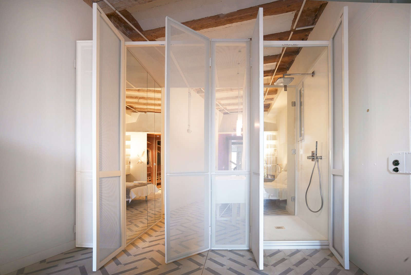 Bath Room, Ceiling Lighting, Pendant Lighting, One Piece Toilet, Open Shower, Freestanding Tub, and Undermount Sink The LightBox also contains the wet area.  LIGHTSLICE apartment